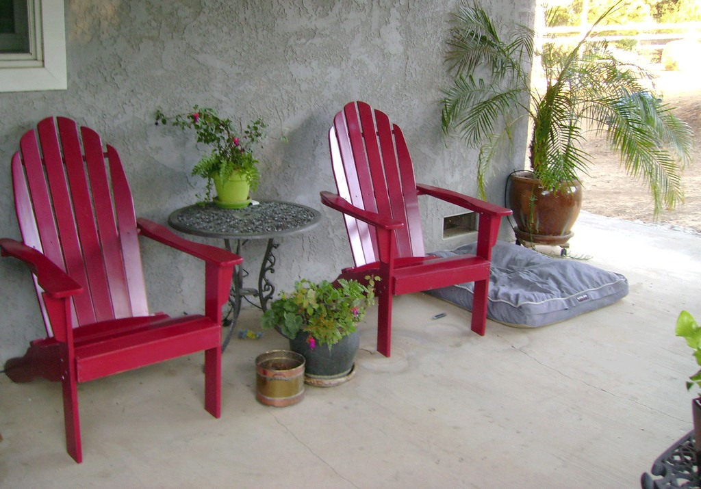 Red chairs on porch